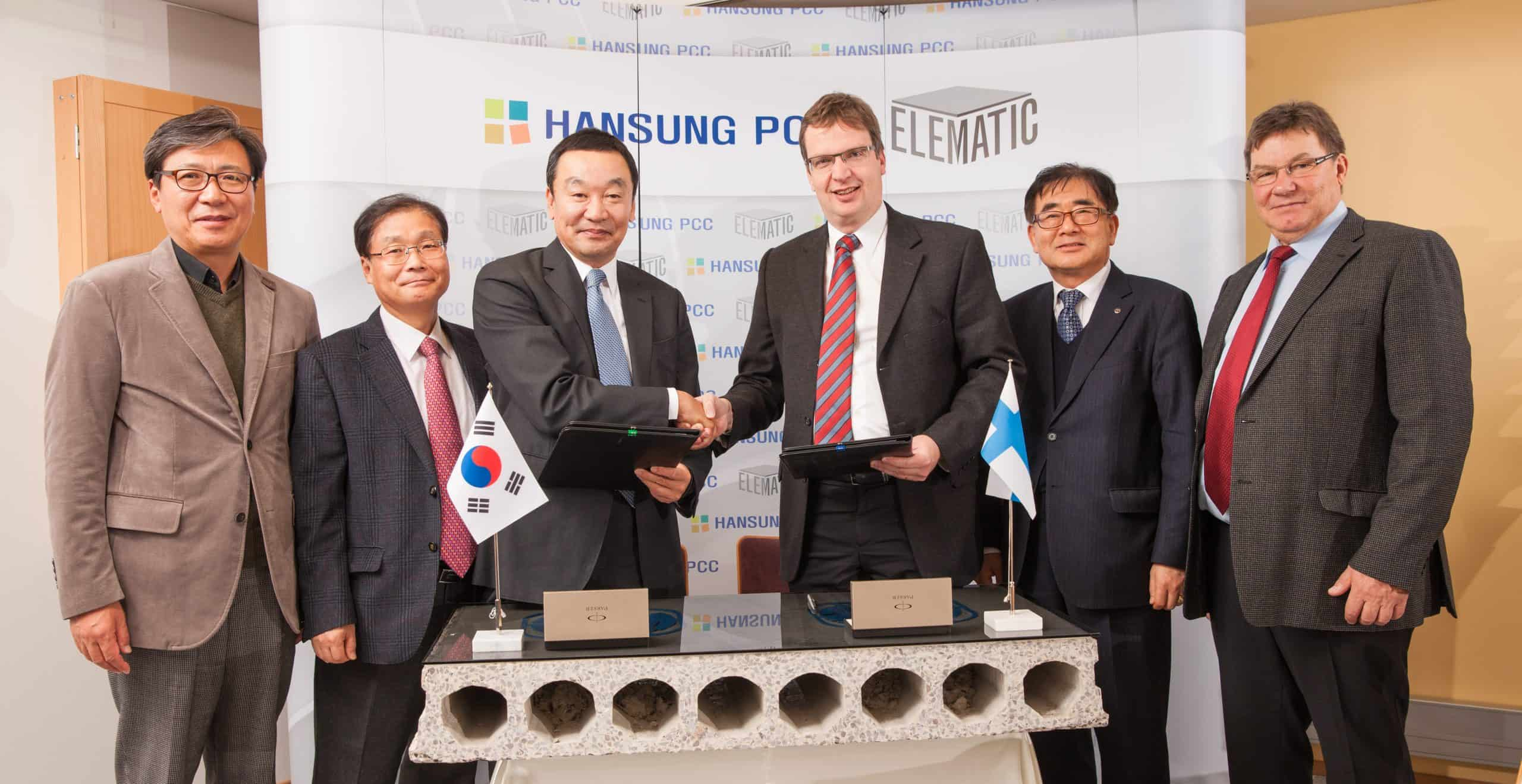 Mr. Koo, Cha-Chul, Chairman of Hansung and YESCO shaking hands with Mr. Mats Jungar, CEO of Elematic Oy AB.